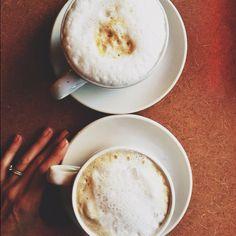 enjoying oversized cappuccinos