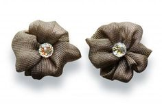 Beautiful flowers made of lurex hemmed by hand displaying a glistening cristal Swarovski crystal.  http://mysfashion.com