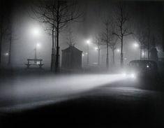 Framed and actually has lights that light up for some of the lamps and the head lights shown in the picture--Brassaï photograph from 1930s of a street in Paris.