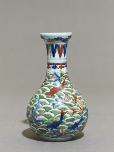 (Ming dynasty) Wucai ware Porcelain Vase with fish amid waves. Ming dynasty, Wanli Mark and Period - porcelain, with underglaze painting in cobalt-blue and polychrome overglaze enamels, cm × cm × at base cm. Ashmolean Museum, University of Oxford Japanese Porcelain, Fine Porcelain, Porcelain Ceramics, Oriental Furniture, Chinese Ceramics, Ceramic Materials, Porcelain Jewelry, Chinese Antiques, Blue China