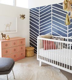 What a great idea. Rather than overhauling a whole room why not paint or wallpaper one-side in a graphic print. This style of room will grow with bub throughout and can easily be converted into a guest bed, reading room or stylish study. The navy and white combo is just classic styling.    The Animal Print Shop Nursery