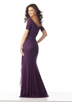 Estilo ENLOZ Stretch Mesh Evening Gown with Draping and Beading Stretch Mesh Evening Gown with an Asymmetrically Draped V-Neck Bodice. A Cascading Side Ruffle and Beaded Detail at the Waist Complete the Look Colors: Black, Eggplant Couture Dresses, Bridal Dresses, Prom Dresses, Formal Dresses For Women, Dresses For Sale, Mori Lee Bridal, Mori Lee Dresses, Chiffon Ruffle, Chiffon Dress