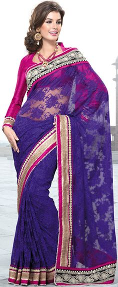 Dreamy variation on shape and forms compliment your style with tradition.   This purple net saree is nicely designed with embroidered patch work is done with resham, zari, sequins and stone work.   Beautiful embroidery work on saree make attractive to impress all.   This saree gives you a modern and different look in fabulous style.   Contrasting dark pink blouse is available.   Slight color variations are possible due to differing screen and photograph resolution.