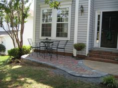 new front patio now what we ripped out all of our bushes - Front Patios Design Ideas
