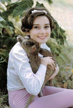 Audrey Hepburn holding her pet fawn