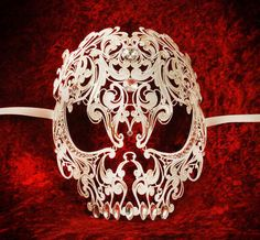 "Luxury Venetian Skull mask ""Teschio"" - Magnificent Venetian luxury mask in the design of a skull. The skull mask has been created out of delicate fret work metal which has then been lavishly embellished with Swarovski crystals. These Venetian masks are very lightweight and so comfortable to wear."