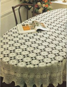 Wow! Crochet this 'Oval Masterpiece' tablecloth.  Pattern is in English, (over 3 pages) and graph, mostly made up of motifs, so could make smaller if desired. But what a beauty!!