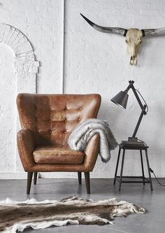 In a beautiful vintage inspired outback tan leather, the Tobin chair will add character to your home.