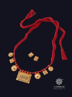 Aipan Necklace : Traditions and cultures evolved over ages to give us the vast diversity in the decorative arts of India. This frugal little neckband is a microcosm of that : A Kumaoni Aipan-inspired centre pendant with Manipuri and South Indian side pieces, all bound with cochineal red thread ----- as if stringing together the richest of rich craft histories in pure 22K gold. Truly, an aesthete's delight.