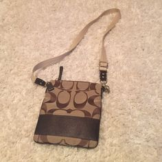 "Coach crossbody. Authentic. Tan and brown small crossbody with classic Coach ""c"" pattern and silver hardware. New condition. No signs of wear. Coach Bags Crossbody Bags"