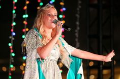 ARCADIA, CA - DECEMBER 14: Actress Emma Degerstedt performs onstage as Westfield Santa Anita celebrates the holidays with a free Winter Wonderland Party at Westfield Santa Anita on December 14, 2014 in Arcadia, California. (Photo by Imeh Akpanudosen/Getty Images for Westfield) — at Westfield Santa Anita.