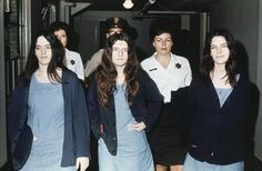 Girls from the Manson Family are escorted through a media swarm by police. Members of Charles Manson's cult following were responsible for a series of murders that terrorised California during the 70s.