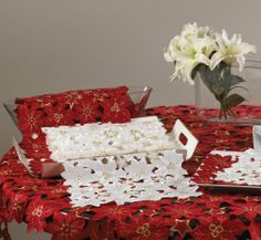 "Holiday Flor De Navidad Cutwork Table Runner . 16""x72"" Oblong. Burgundy Color. One Piece. by Flor De Navidad. $24.99. Machine washable; imported. Made of 100% Polyester. Measures 16 inch by 72 inch. Burgundy color. This table runner  is done in the elegant style with embroidered and cutwork Flor De Navidad Design. It's nice and neat in any occasions and will become an valuable addition to your home decor.. Save 54% Off!"