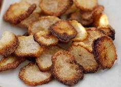 Daikon Chips Ingredients Peeled and thinly sliced radish A good glug of olive oil A pinch of salt and pepper Preheat the oven to 385°F. Toss...