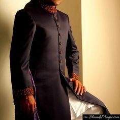 Junaid-Jamshed- Black sherwani.  The designer sherwani with simple royal color and elegant touch for your wedding can be of your interests.