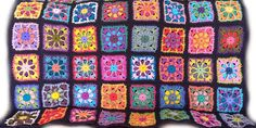 Crochet afghan kaleidoscope granny square 44 x 58, navy blue border, MADE TO ORDER