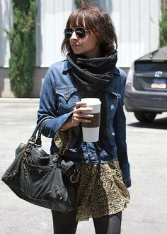 Animal print skirt, chunky bag, jean jacket, wrap-around scarf, and coffee. All right all right.