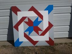 JEAN & GENE SCHENDT'S BARN QUILT #3 LOCATED IN NUCKOLLS COUNTY SOUTH AND EAST OF LAWRENCE, NEBRASKA -- THIS ONE IS CALLED FAITH AND FAMILY