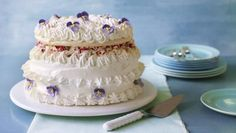 Gloriously billowy and wildly retro, to say this complex meringue dessert decorated with fondant violets will be a talking point is an understatement!   Equipment and preparation: you will need a piping bag fitted with a 1.5cm/⅝in plain nozzle, a piping bag filled with a large star nozzle, a clean small paintbrush, a sugar thermometer and a 30cm/12in heatproof (to 120C) serving plate for this recipe.