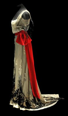 fawnvelveteen:  Evening gown, Paquin, 1911. Ivory satin, black velvet dévoré, and ivory tulle, hand-embellished with glass beads. Cerise sas...| JV