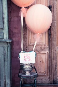 Oversized balloons wrapped in tulle.