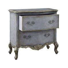 Elegant forms and a sophisticated finish combine to make this a designer-inspired accent piece. The main finish is a soft cloudy, gray-blue tone. The edges, pencil trim on the drawer fronts and the carved onlays found on the base apron and cabriole legshave a metallic sheen, allowing just enough contrast to draw attention to the details. This chest features two drawers, making it ideal as an accent nightstand.