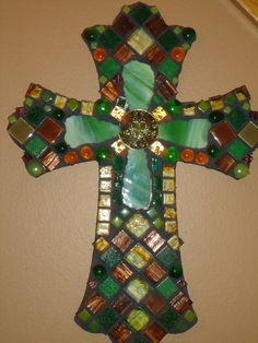 16 long x 12 wide, Bella Verde is just that, Beautiful Green. Made with stained glass, smalti, gold smalti, glass tiles and glass beads, this piece is a timeless beauty that reflects the act of beautiful submission and sacrifice by our Savior on the cross for a world of sin. Using greens, browns and just a touch of gold, its a lovely piece. I hope you enjoy it.