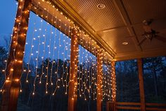hang curtain lights to create a shimmering wall of light across a covered deck or backyard pergola.