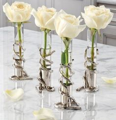 The Branch Bud Vase in Nickel by Global Views is elegant and petite perfect when bought in multiples to create a bud garden on a counter or table. FREE SHIPPING. $48