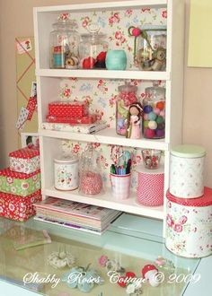 The lovely little shelves!! That is the same wallpaper I used covering my wee bread bin organiser. Those greengate tins are definitely worth stealing :p