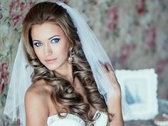 Wedding hairstyles for long hair- it's off her face but still frames her face