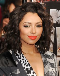 Kat Graham at the #MTVMovieAwards in a bright orange lip.