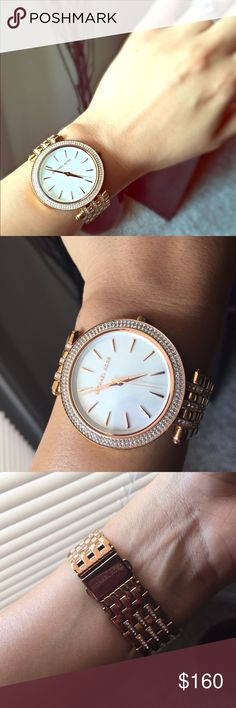 Beautiful authentic Micheal Kors rose gold watch 30mm round face rose gold watch. Gently worn on few occasions. Beautiful stones giving it a clean classy look. No scratches just needs cleaning. No extra links. Fits a medium wrist like mine. Michael Kors Accessories Watches