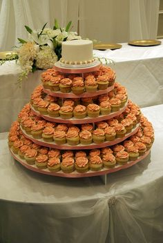 Cupcake Tower - Like the idea of having  a small cake at the top to save for our anniversary!