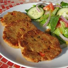 Super Easy Salmon Cakes Allrecipes.com- Good with g.f. bread crumbs and cooked in a sprayed nonstick skillet.