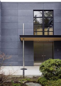 fiber cement panels Exterior Contemporary with Cembonit siding cement board siding dark cement paneling downspout Cement Board Siding, Fiber Cement Board, Fiber Cement Siding, House Siding, Facade House, Modern Exterior, Exterior Design, Modern Entry, Architecture Restaurant