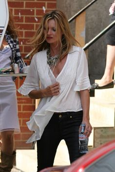 Kate Moss in black jeans, statement necklace and white peasant t-shirt flowing shirt