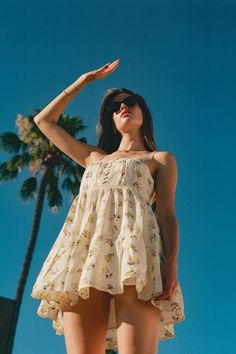 Keep it short and sweet with this mini dress from UO. Cut in relaxed, frock-style silhouette with lace inset accents at the tiered ruffle design. Fitted with a button-front closure at the and adjustable spaghetti straps. High Waisted Baggy Jeans, Short Frocks, Urban Dresses, Casual Summer Dresses, Stylish Dresses, Lace Inset, Event Dresses, Babydoll Dress, Shirt Dress