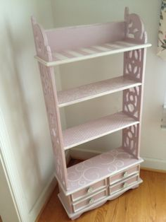 Fun pink decorative shelving piece for a young girl -- unique, carved wooden shelves painted in Annie Sloan chalk paint colors Antoinette and Old White, with stenciled designs.  $150 at ArtSpring in Takoma Park, MD.