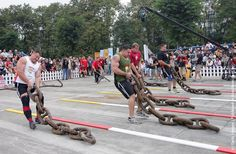 (L-R) Jessen Paulin of Canada, Kevin Nee and Dave Ostlund of USA, Janne Virtanen of Finland drag huge iron chains during a match of the 2005 Worlds Strongest Man Competition at Wuhou Temple http://avaxnews.net/appealing/Worlds_Strongest_Man_Competition.html