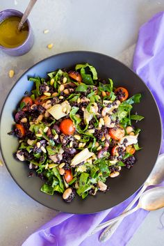 This Mediterranean Black Rice Salad with Roasted Garlic Vinaigrette is the perfect way to stay healthy while also getting lots of delicious flavor in your dish! #VillageHarvestInspired