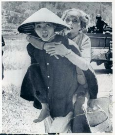 1962 - Vietnamese youth carrying his aged mother