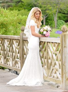 Modest wedding dress with soft lace sleeves from alta moda.