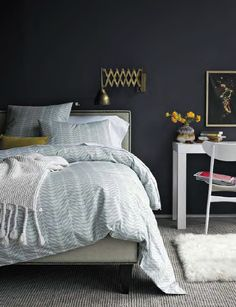dark grey bedroom: great lamp