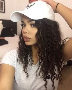 00573f2167c curly hair with a baseball cap ! It s possible lol