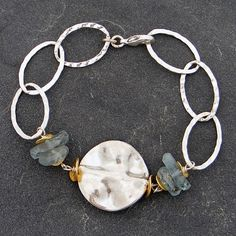 This organically inspired sterling link & aquamarine bracelet features a textured sterling silver center mingled with lovely faceted aquamarine stones and 14kt gold fill ruffle beads.
