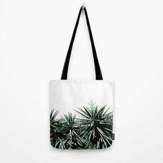 """Yucca Wall Tote bag by ARTbyJWP #totebag #beachbag #handbag #bag #cactus #leaves #minimal Our quality crafted Tote Bags are hand sewn in America using durable, yet lightweight, poly poplin fabric. All seams and stress points are double stitched for durability. Available in 13"""" x 13"""", 16"""" x 16"""" and 18"""" x 18"""" variations, the tote bags are washable, feature original artwork on both sides and a sturdy 1"""" wide cotton webbing strap for comfortably carrying over your shoulder."""