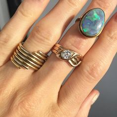 Some special and killer rings from the #ombas Original Miami Beach Antiques Show! Look at that Victorian era .80ct diamond snake ring. The Art Nouveau black opal's flash is insane and really vibrant! (we'll post a video to show it off ) and the ring finger is a Cartier 1970's puzzle ring. We're really excited to add these to our online inventory along with all the other special pieces we pick up in Miami! Available for purchase at abrandtandson.com