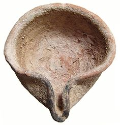 "Crusader Palestine, c. 13th century CE. A nice and very rare Mamluk/Crusader Period ceramic oil lamp. cf. IAA Reports 26: Avissar and Stern, ""Pottery of the Crusader, Ayyubid, and Mamluk Periods in Israel"", p. 171, pl. 4. (Type III.3.1.1). 63x66 mm (2 1/2"" x 2 3/4"". Well-preserved with traces of original white slip, spout still charred from ancient use! ex-Robert Deutsch; ex-Archaeological Center, Tel Aviv. #AM2061: $225 Ancient Resource: Medieval Artifacts From the Crusades"