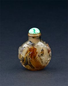 A well hollowed agate snuff bottle, carved with flowers and trees by rockwork. China, 1750-1860